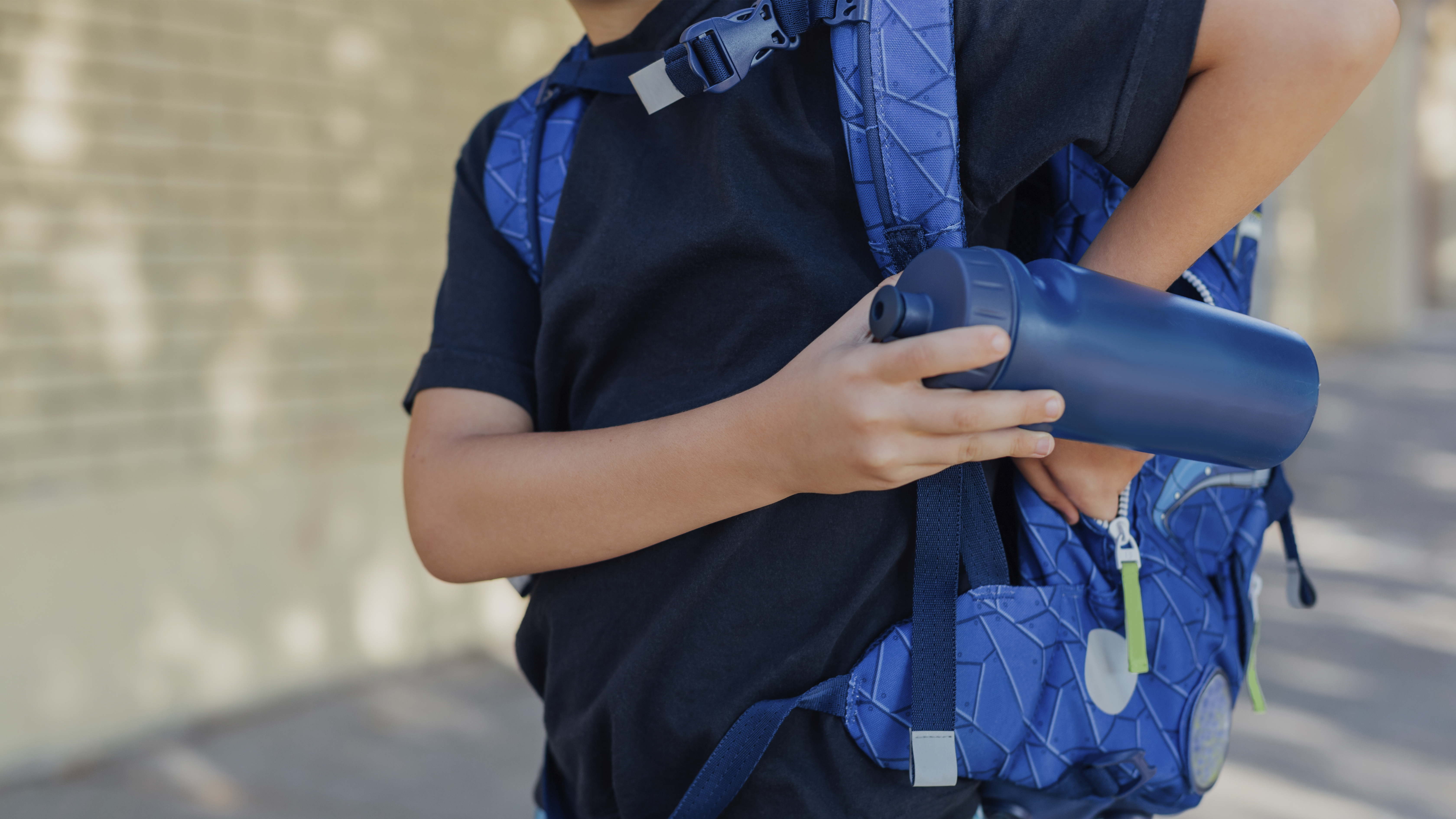 Kid with sports drink bottle
