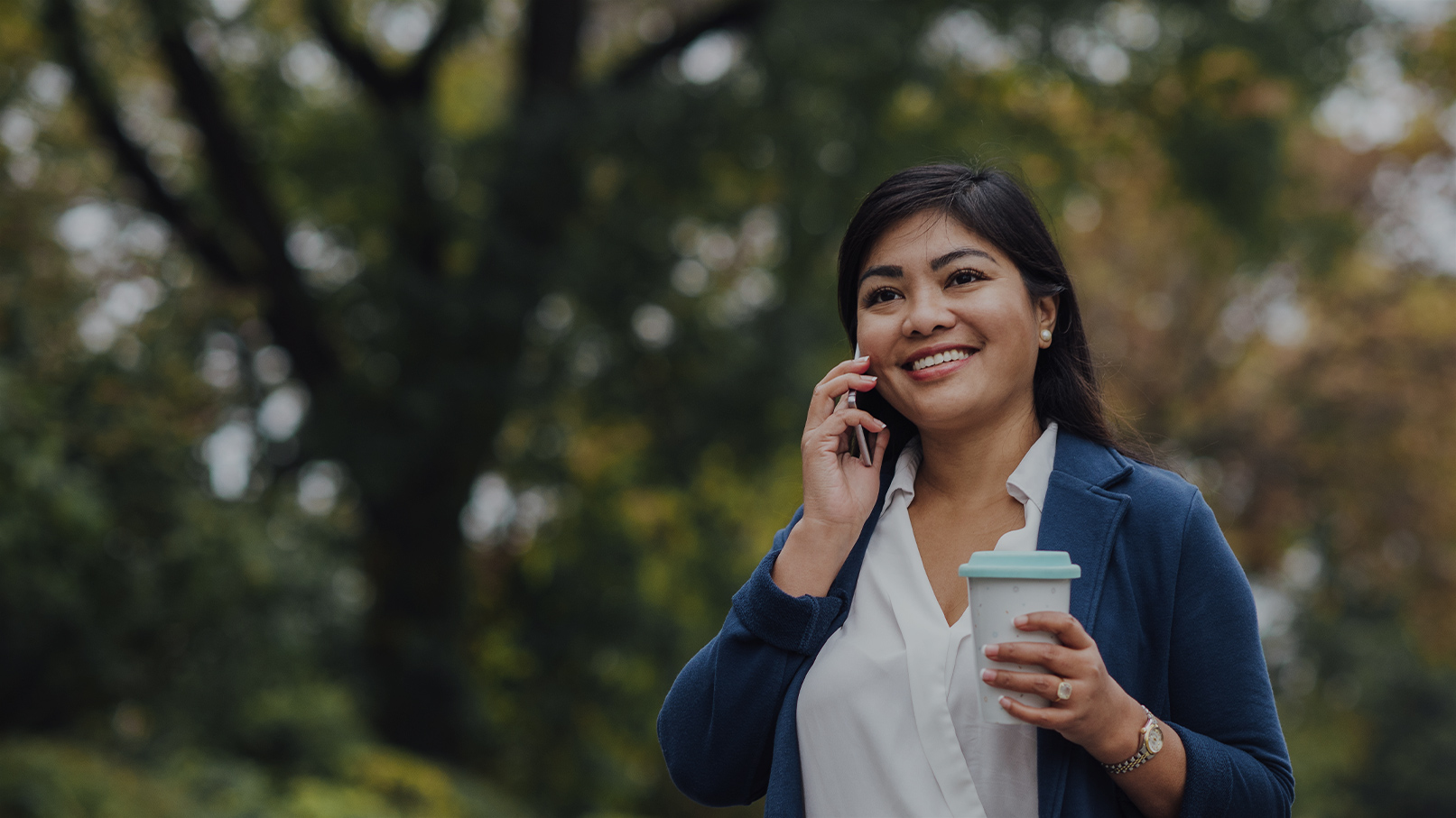 Woman walking while on cell phone
